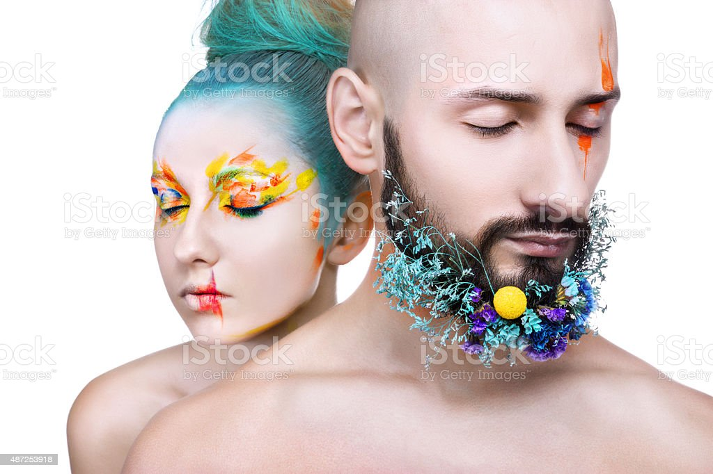 Girl and man with colorful makeup royalty-free stock photo