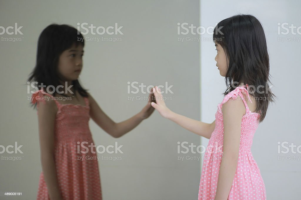 girl and mirror stock photo