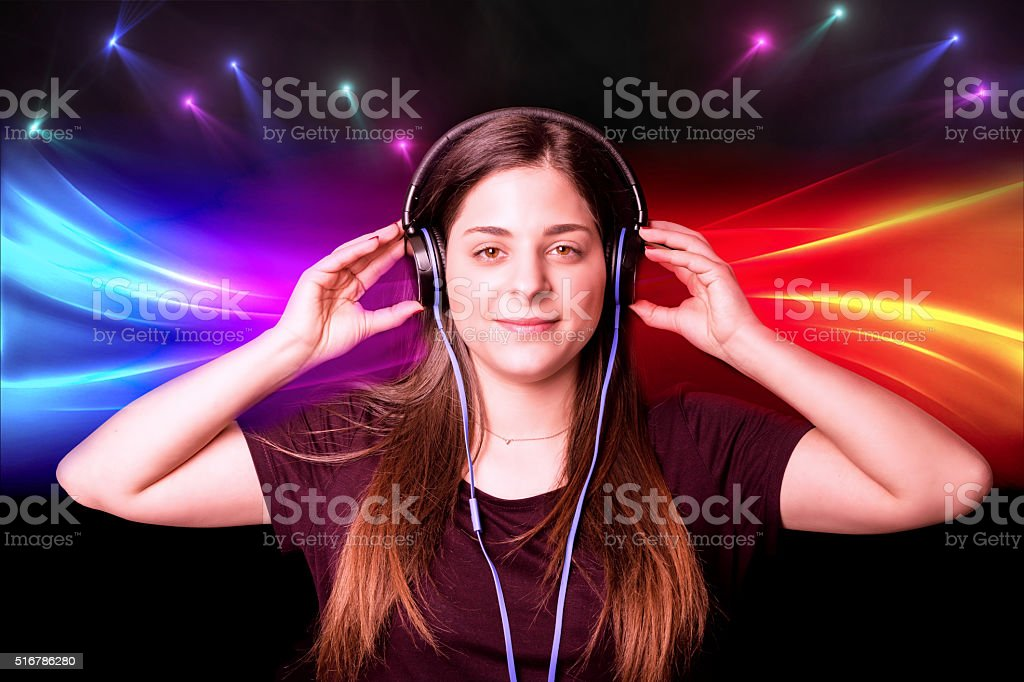 Girl and music, with light effects stock photo