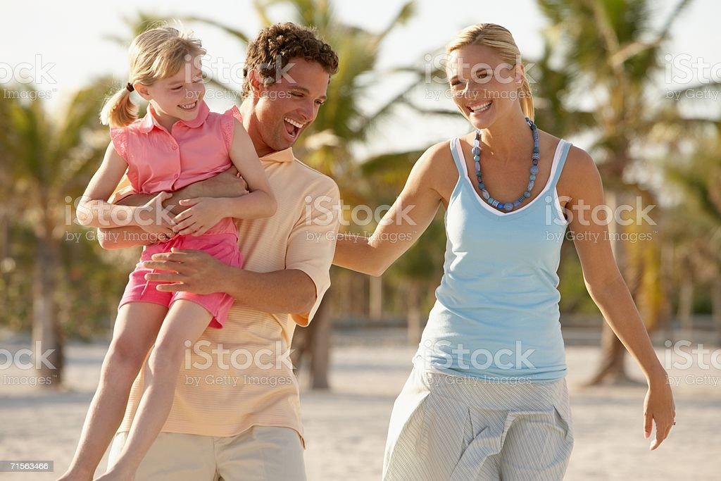 Girl and parents having fun stock photo