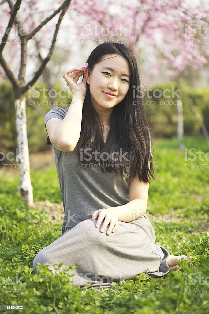 Girl and peach blossom royalty-free stock photo