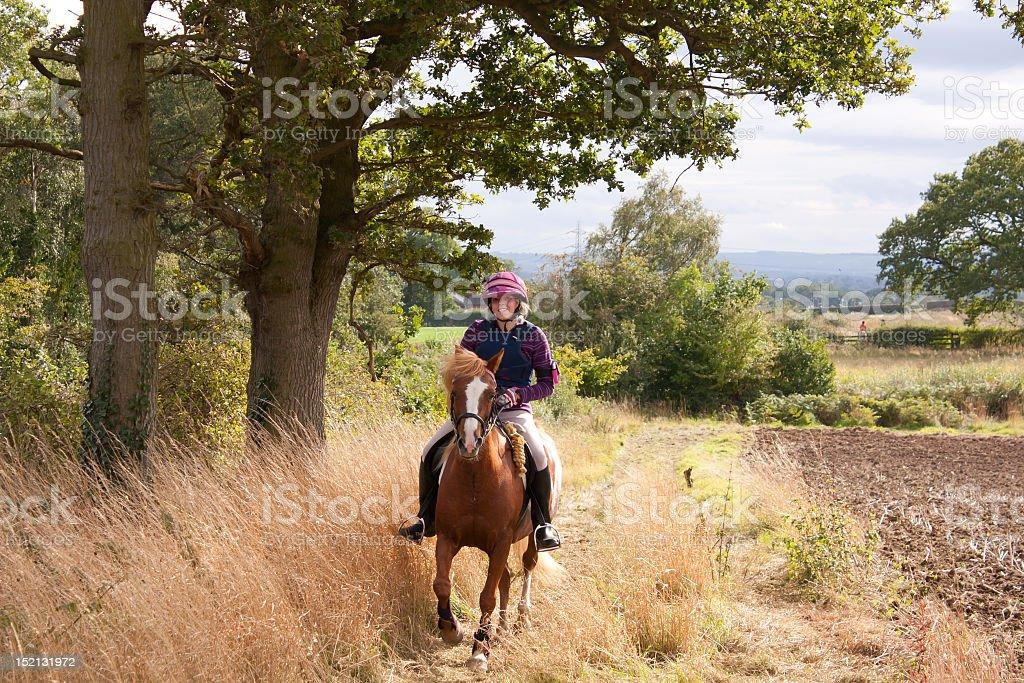 Girl and pony enjoying the english countryside on funride. royalty-free stock photo