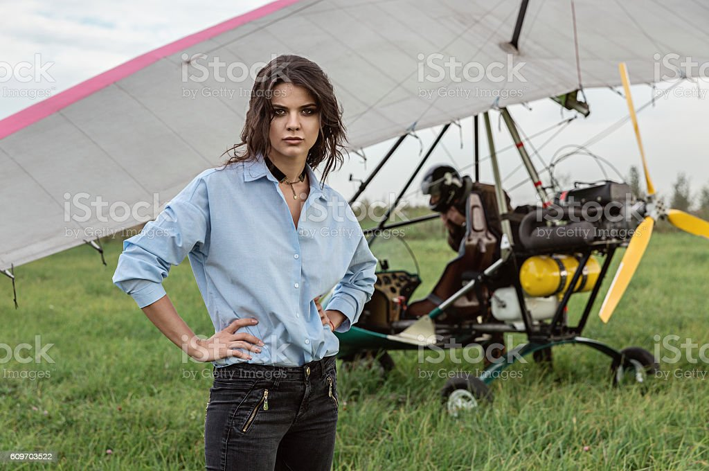 Girl and powered paragliding pilot. stock photo