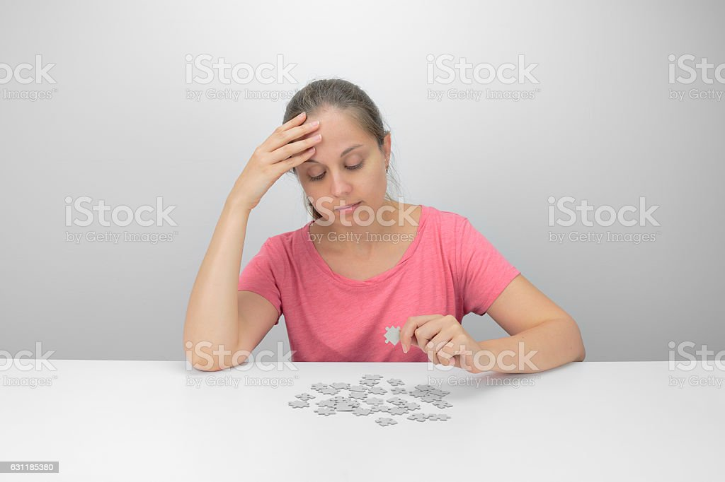 girl and puzzle stock photo