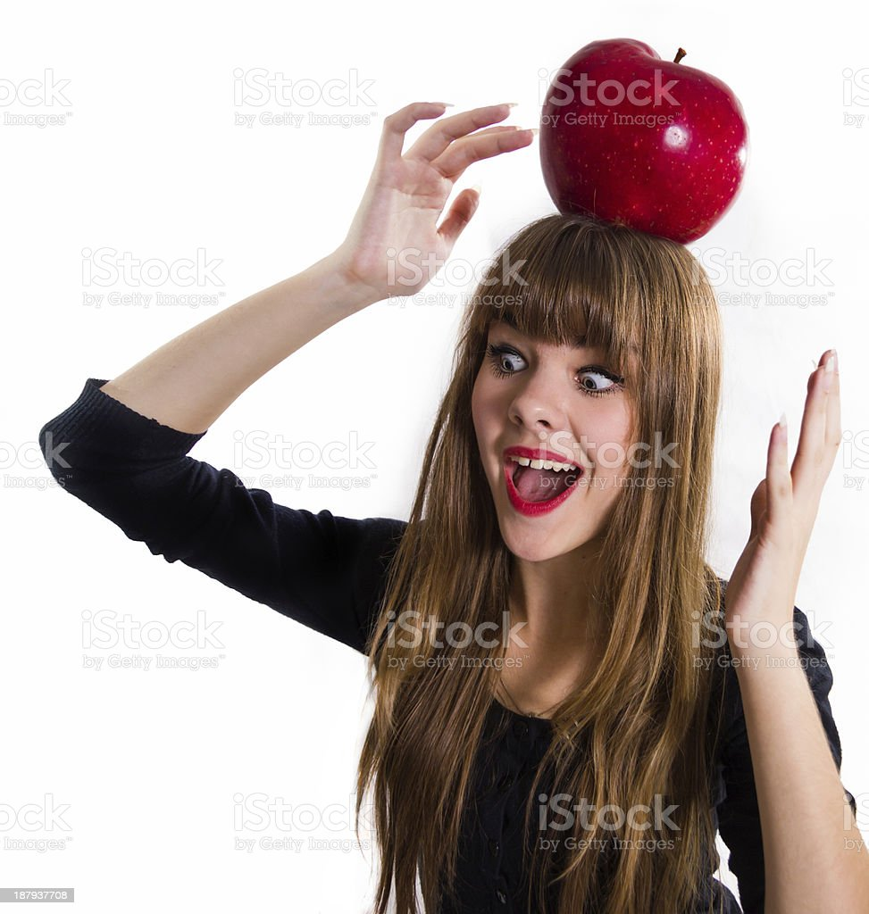Girl and red big apple. royalty-free stock photo