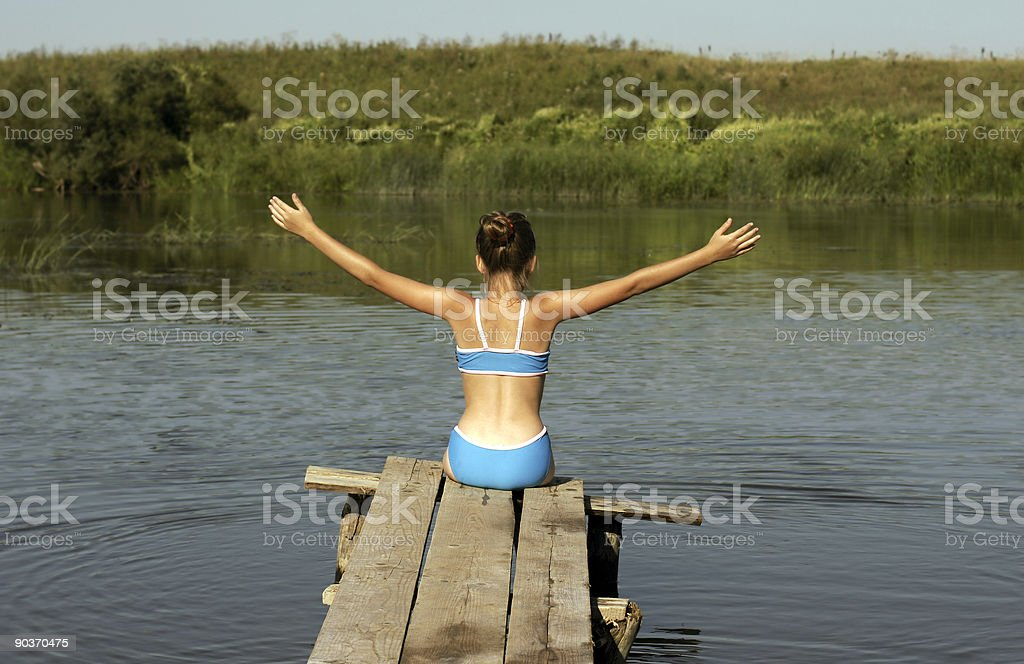 Girl and river. royalty-free stock photo