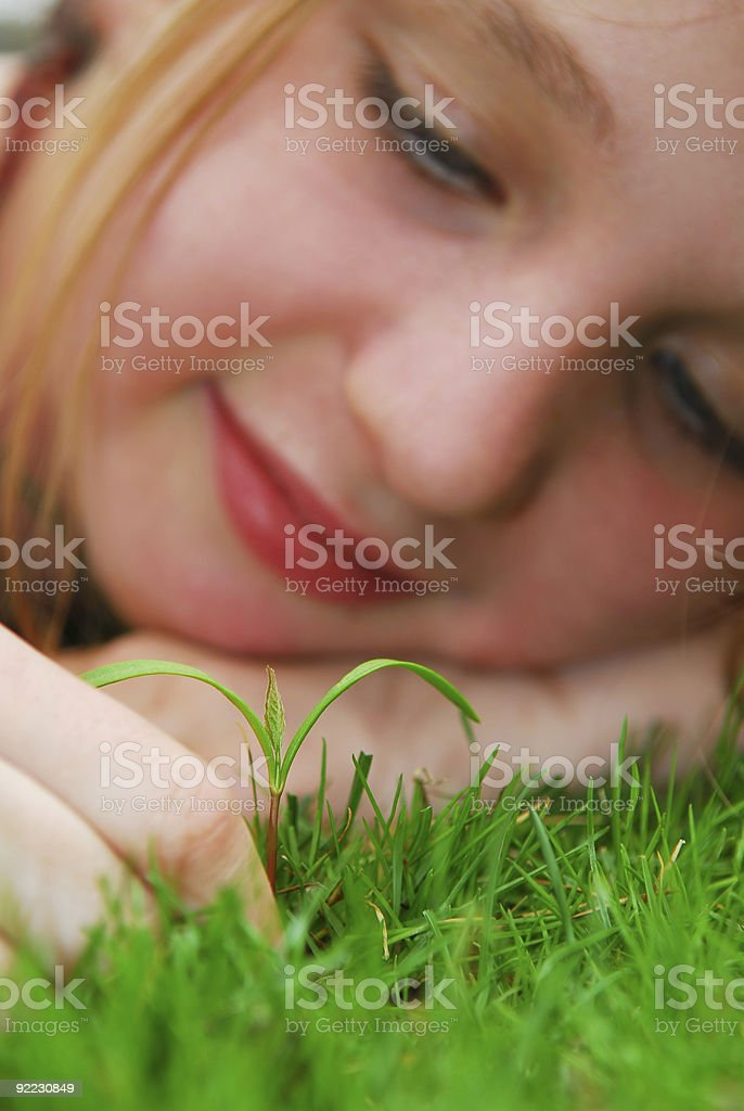 Girl and seedling royalty-free stock photo