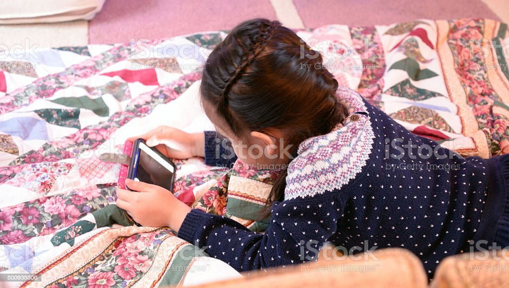 Girl and Smart Phone stock photo