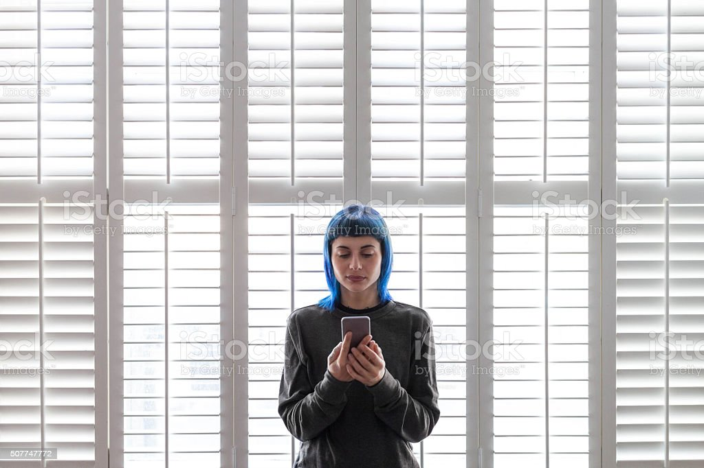 Girl and smartphone stock photo