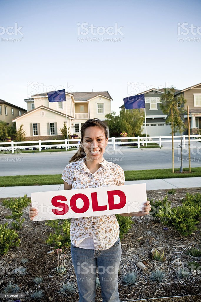 girl and sold sign in front of house royalty-free stock photo