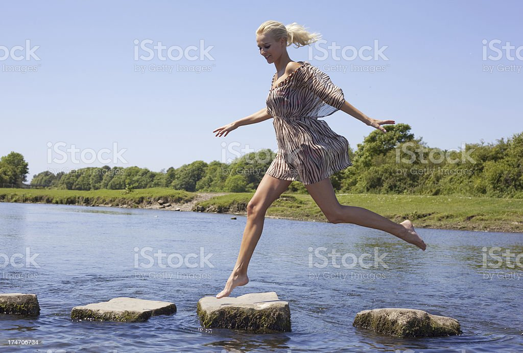 girl and stepping stones royalty-free stock photo