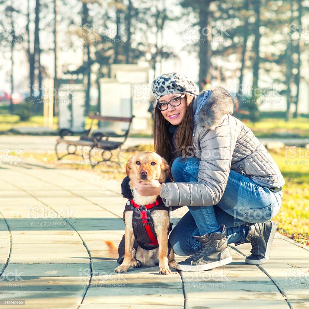 Girl and sweet dog stock photo