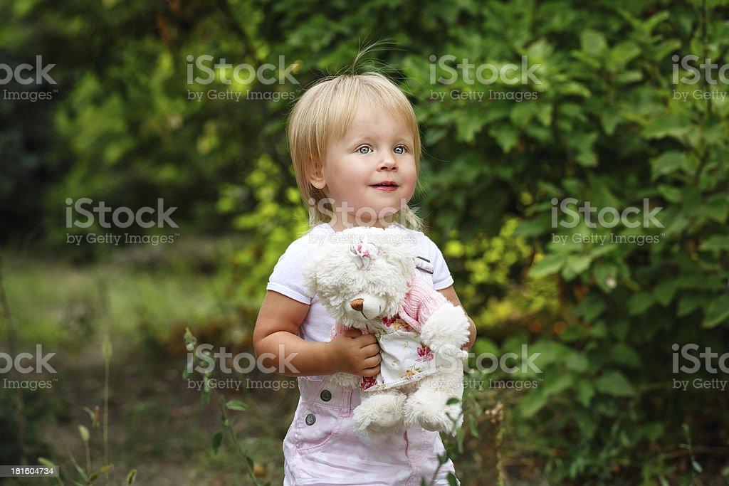 Girl and teddy bear royalty-free stock photo