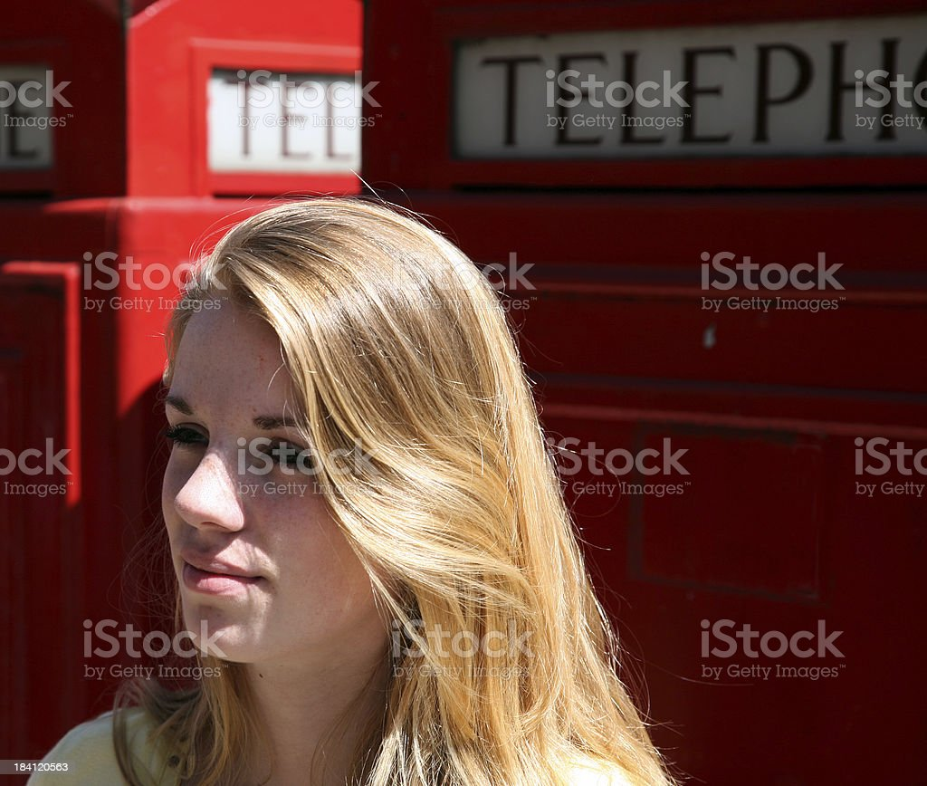 Girl and telephone booth royalty-free stock photo