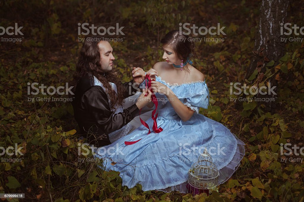 Girl and the man tied its own hands. stock photo