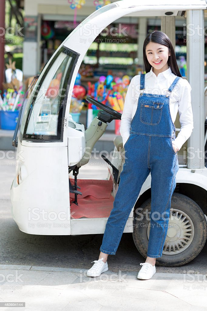 girl and tourist vehicles stock photo