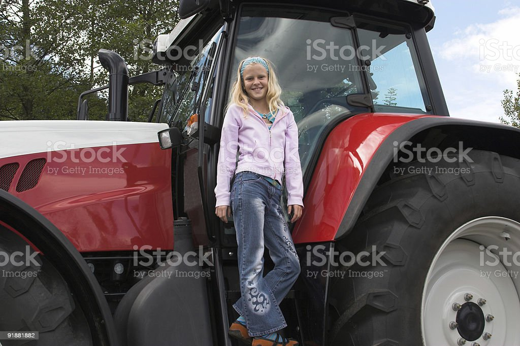 Girl and tractor royalty-free stock photo