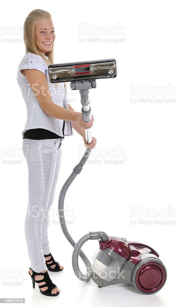 girl and vacuum cleaner stock photo
