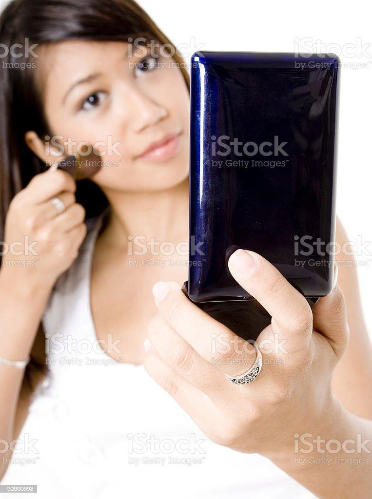 Girl Applying Foundation royalty-free stock photo