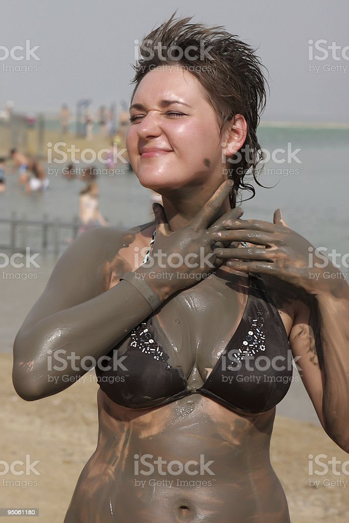 Girl Applying Mineral Mad royalty-free stock photo