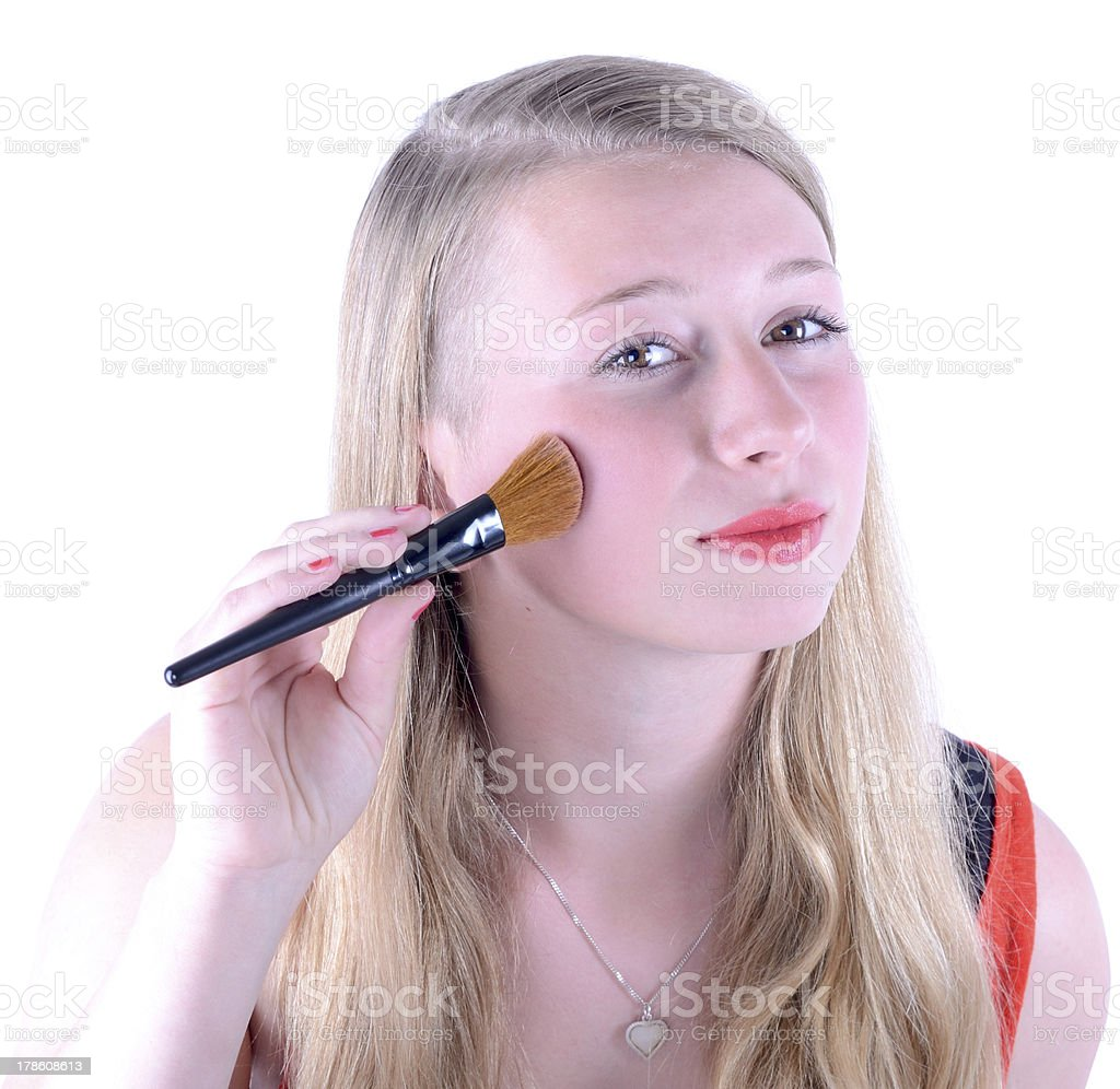 girl applying rouge white background royalty-free stock photo
