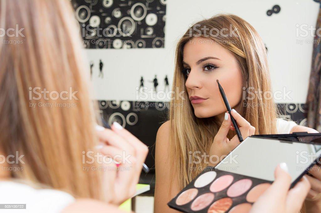 Girl applying shadow stock photo