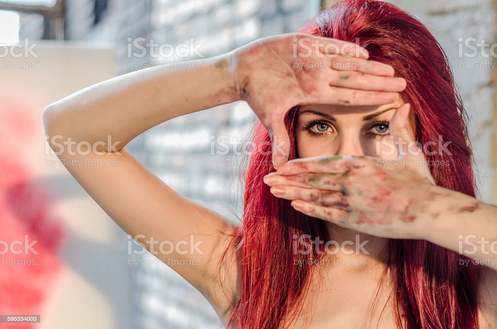 Girl artist showing dirty hands, painter copies gestures with hi stock photo