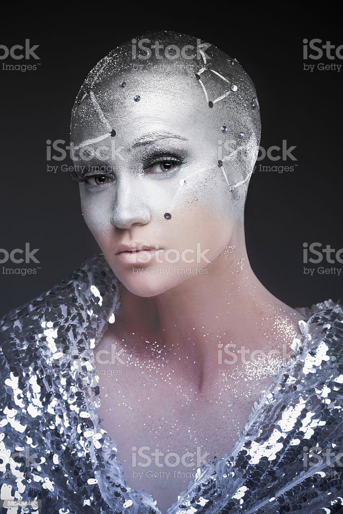 Girl astronomer. Cosmological astrologer. Makeup. stock photo
