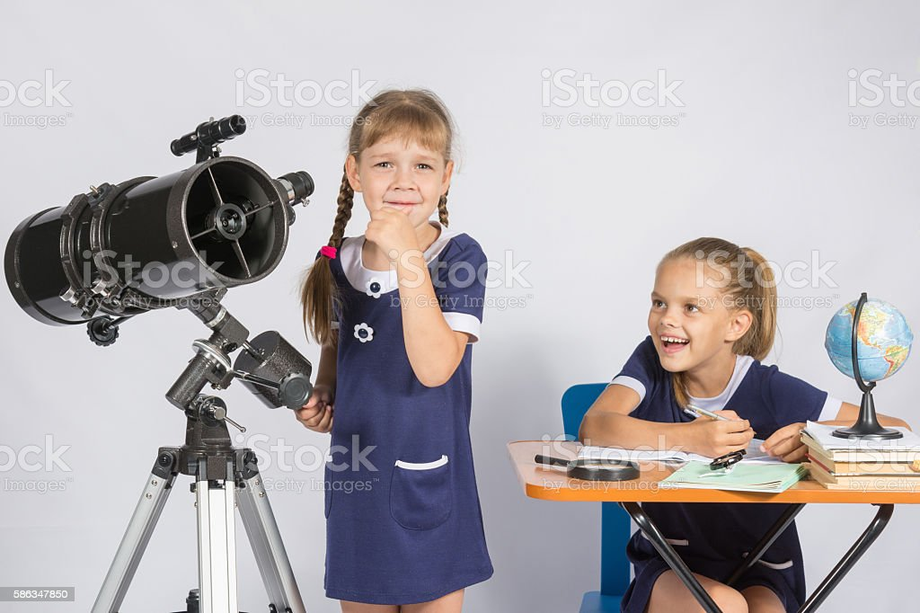 Girl astronomer thought, another girl with smile looking at her stock photo