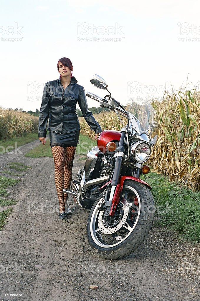 Girl at a motorcycle royalty-free stock photo