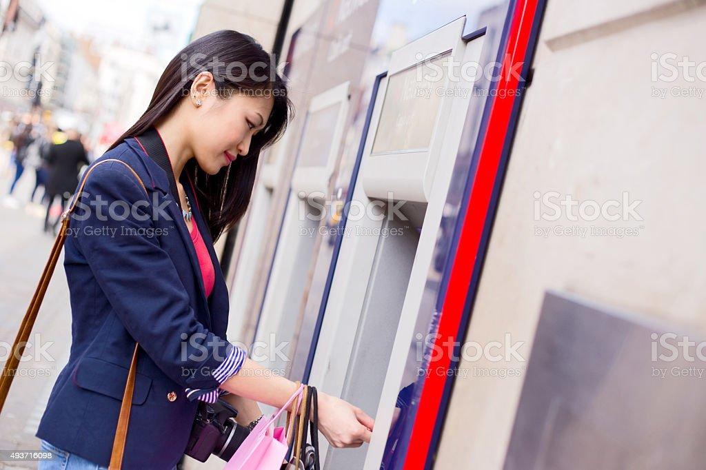 girl at ATM royalty-free stock photo