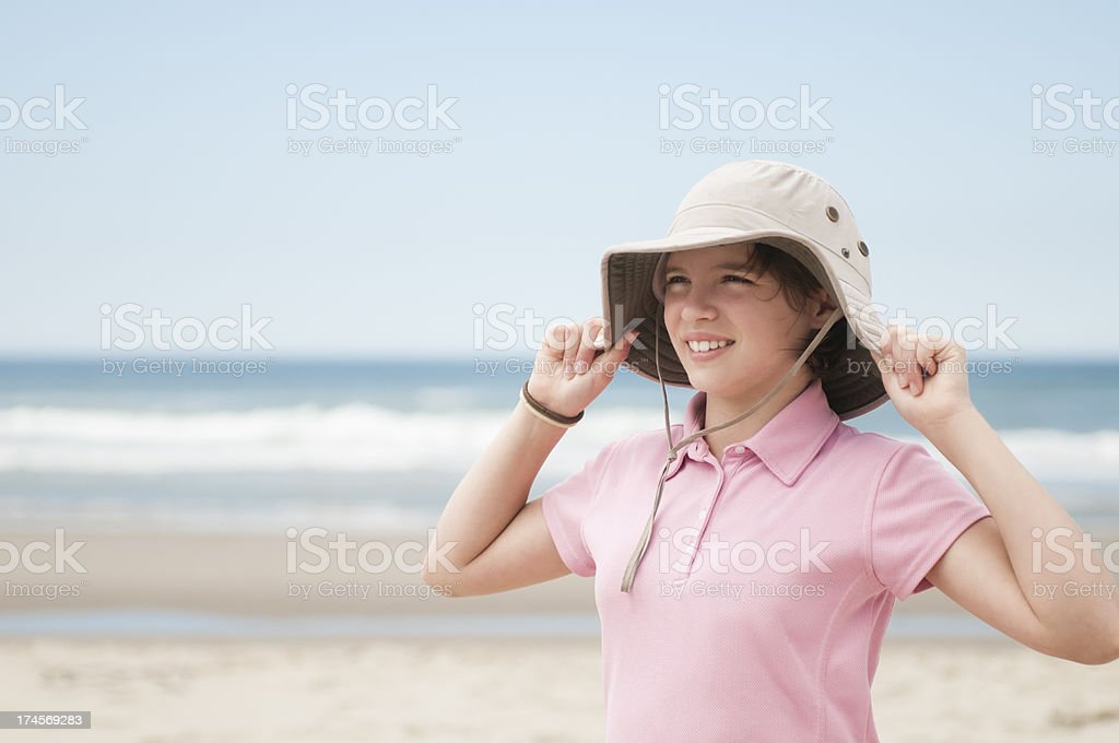 Girl at Beach With Hat royalty-free stock photo