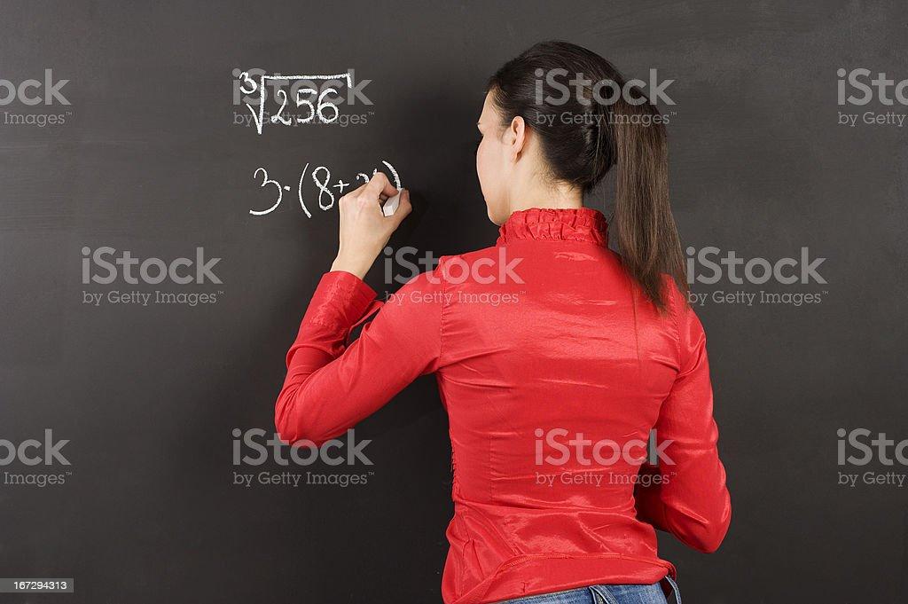 girl at blackboard royalty-free stock photo