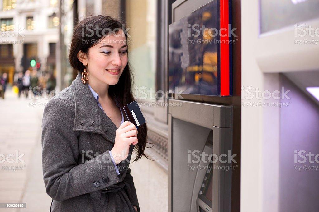 girl at cash machine royalty-free stock photo
