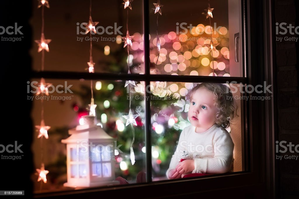 Girl at Christmas eve stock photo