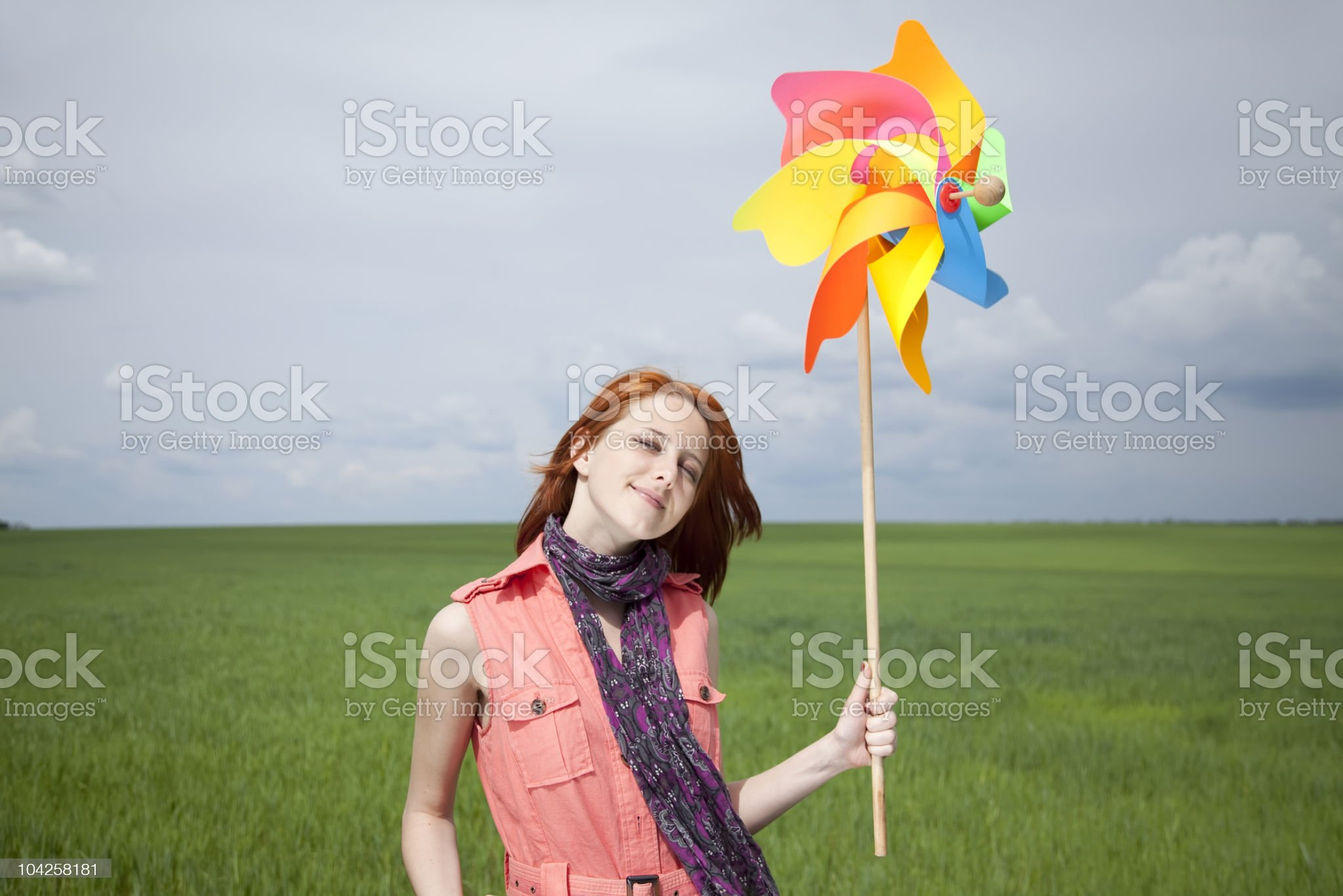 Girl at green wheat field with wind turbine royalty-free stock photo