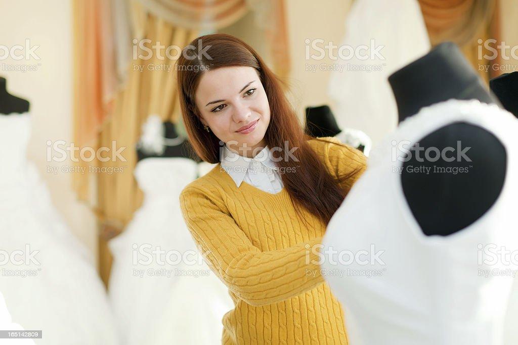 Girl  at shop of wedding fashion royalty-free stock photo