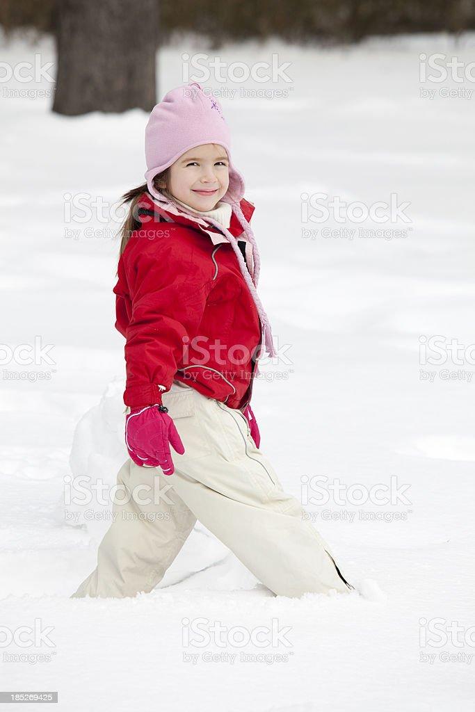 Girl at snow stock photo