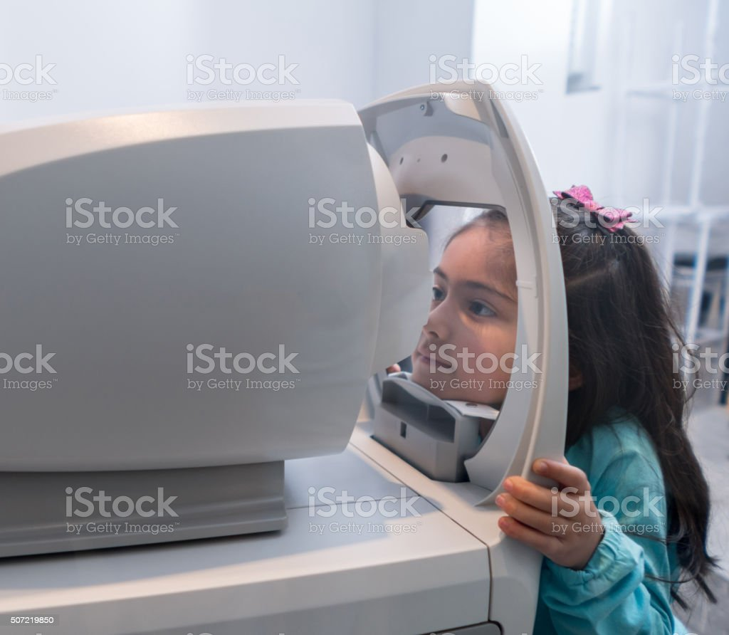 Girl at the eye doctor stock photo