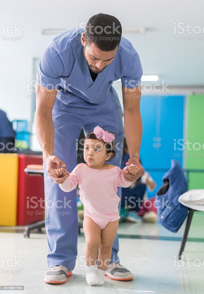 Girl at the hospital in early stimulation therapy stock photo