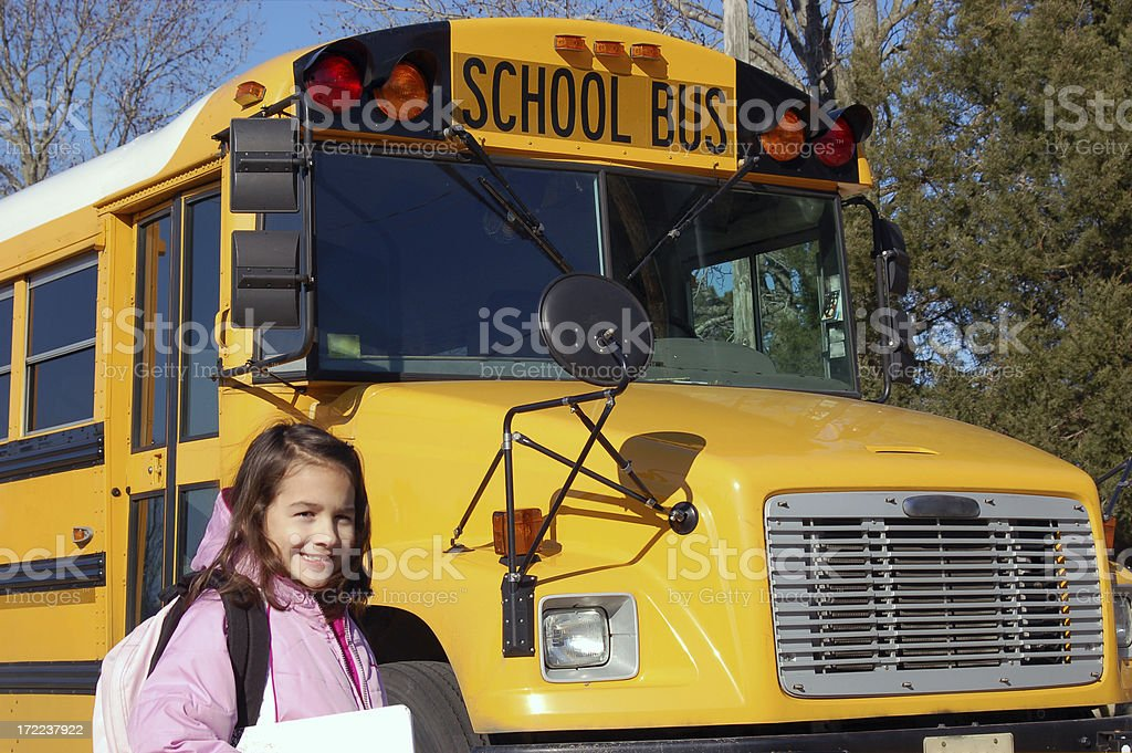Girl at the School Bus royalty-free stock photo