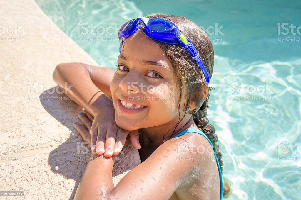 Girl at the Swimming Pool stock photo