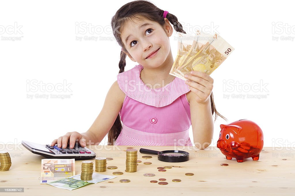 Girl at the table counts money royalty-free stock photo