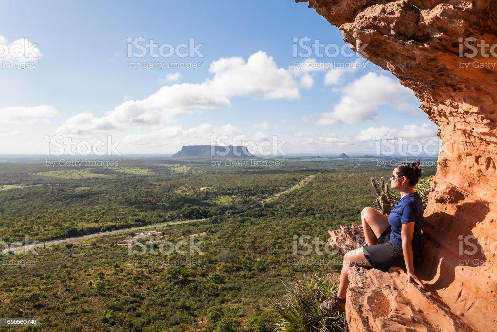 Girl at the top of Chapada's Portal - Carolina, Maranhao, Brazil stock photo