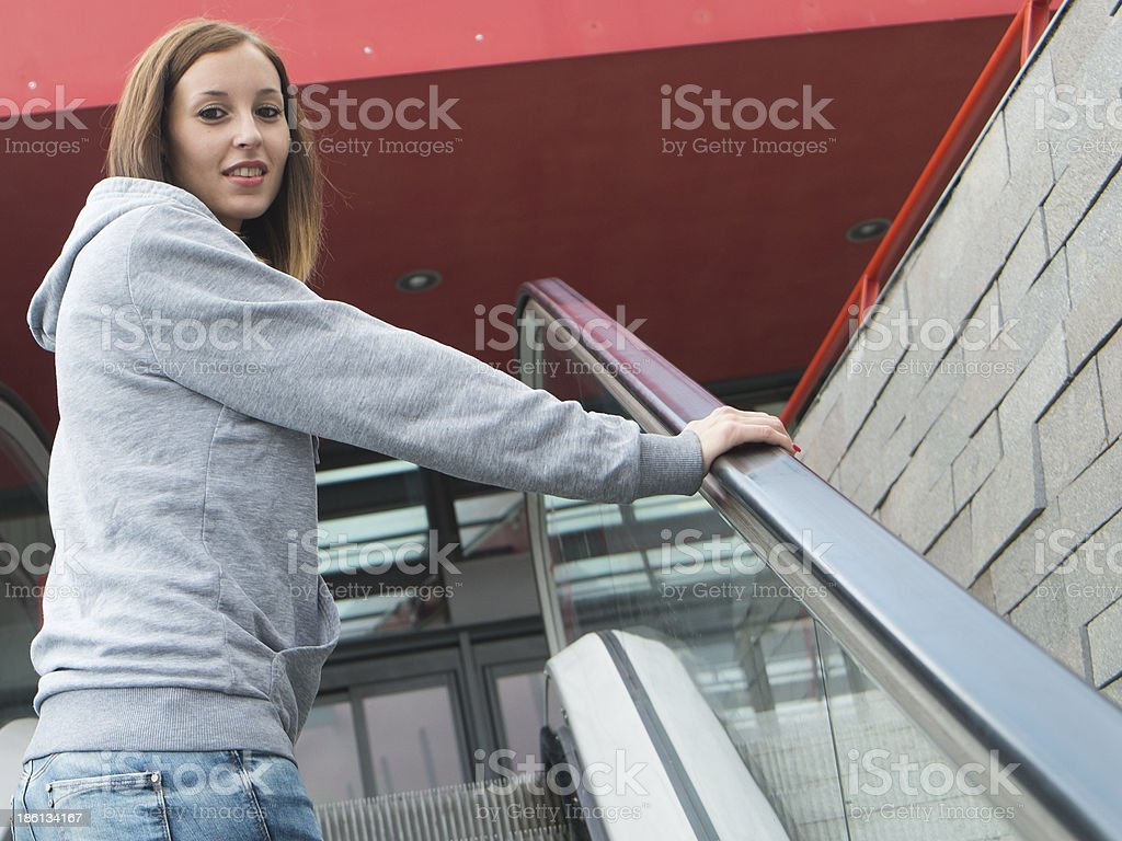 Girl at the top of escalator royalty-free stock photo