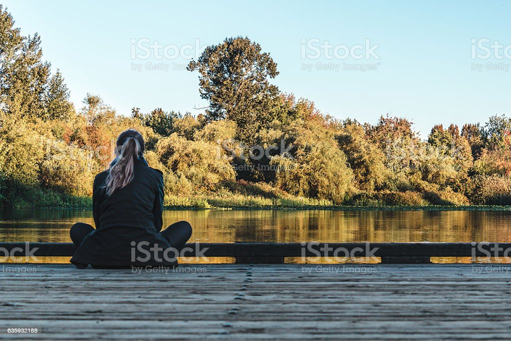 Girl at Trout Lake in Vancouver, Canada stock photo