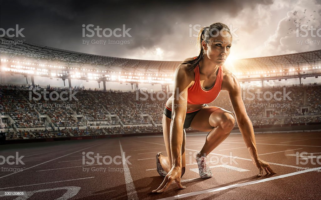 Girl Athlete Getting Ready to Run stock photo