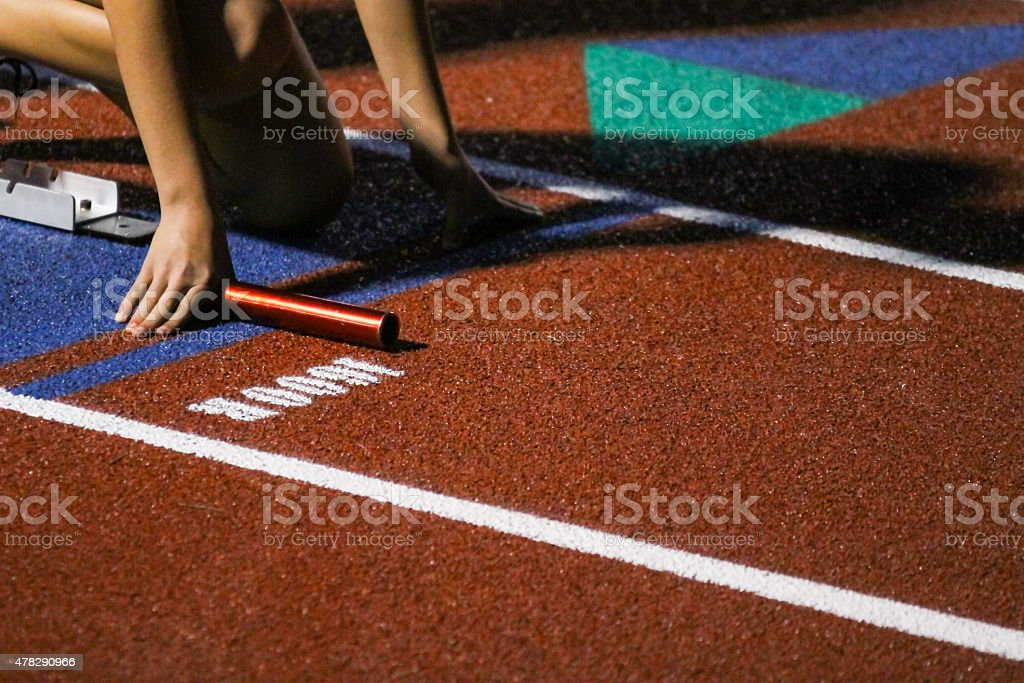 Girl Athlete In Track Starting Blocks - Stock Image stock photo