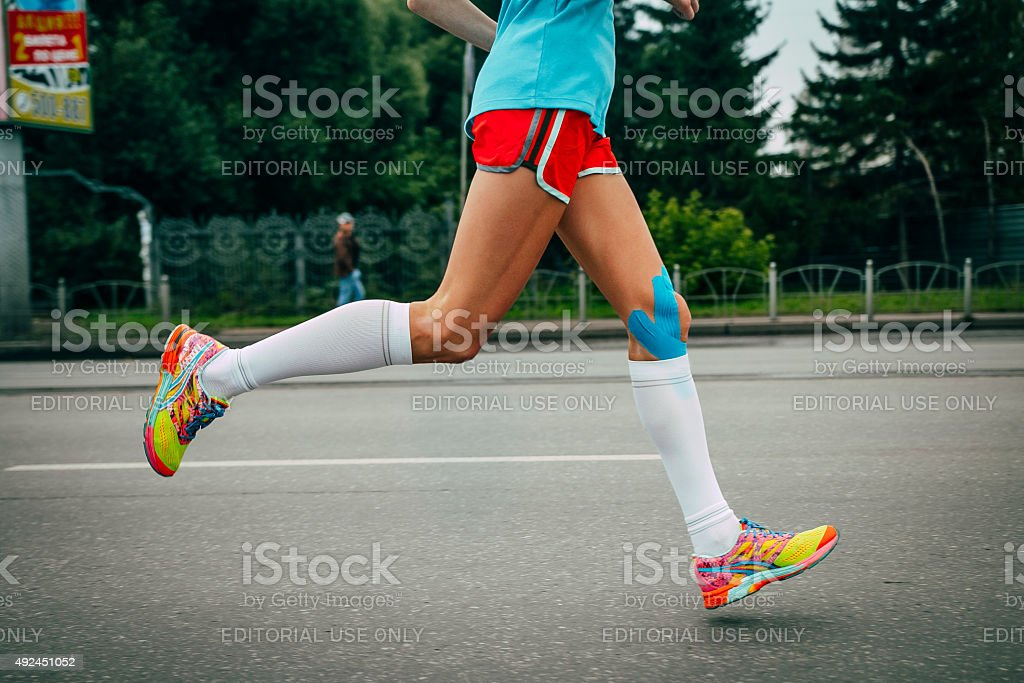 girl athlete running a marathon stock photo