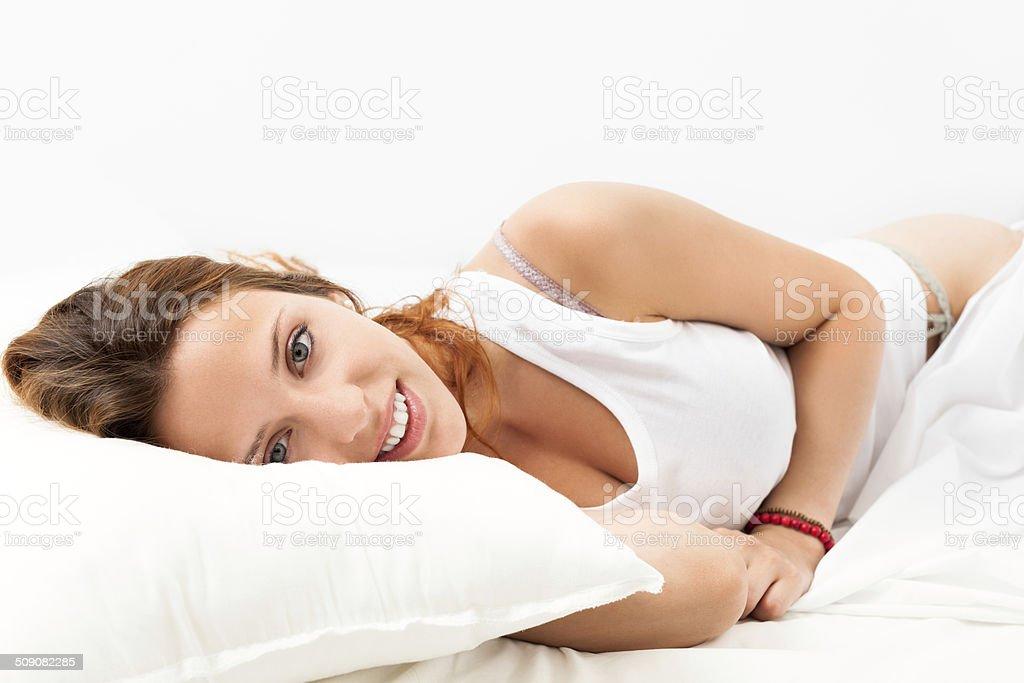 girl   awaking on white pillow stock photo